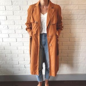 Vintage rust coloured long belted trench coat